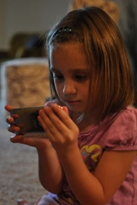 Silvia using her iPod touch.