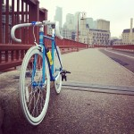 My new blue bicycle from State Bicycle Co. on the Stone Arch Bridge in Minneapolis.