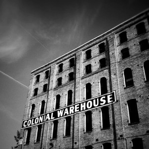 Black and white photo of a warehouse.