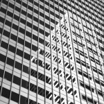 Black and white photo of reflections on buildings in downtown Minneapolis.